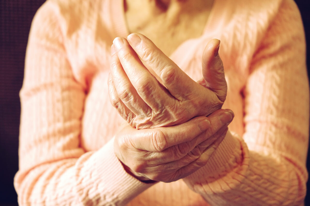 Close up of mature womans hands. Health care giving, nursing home. Parental love of grandmother
